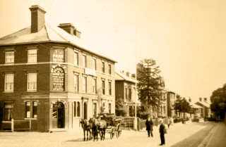 "The Park Hotel around 1911. This picture was taken by 'One-Arm' Smith on a glass plate. A sign in the window says ""Under Entirely New Management"". Joseph Trayler became the new landlord in 1911. 