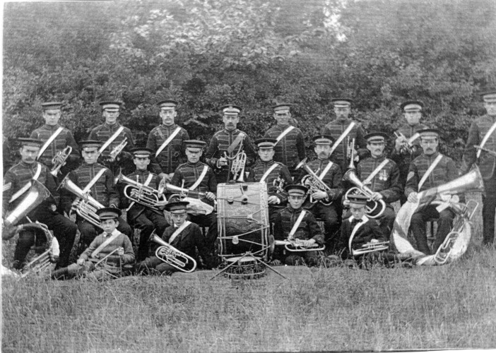 The Wivenhoe Welslyan Brass Band in 1911.  One of the men is wearing medals, probably from the Boer War  but possibly won in India, | Nottage Maritime Institute 02674