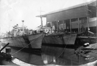 Vosper's wet dock, ML276 and ML345 in the dock for repairs, with RML547 in the shed. | Nottage Maritime Institute 02848