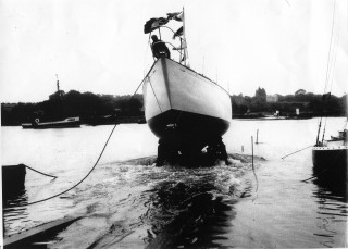 The launching of the Herald of Wivenhoe from Guy Harding's Colne Marine & Yacht Co. Ltd.'s yard on Wivenhoe Quay, 1963.    Nottage Maritime Institute 04002b