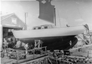 The Herald of Wivenhoe on Wivenhoe Quay before launch.   Nottage Maritime Institute 04002x