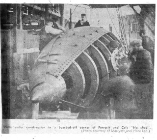 The Volta under construction in the building shed.  Her cramped interior, thick frames and plating, and the size of her rivets are very obvious. | Nottage Maritime Institute 04332.4.053