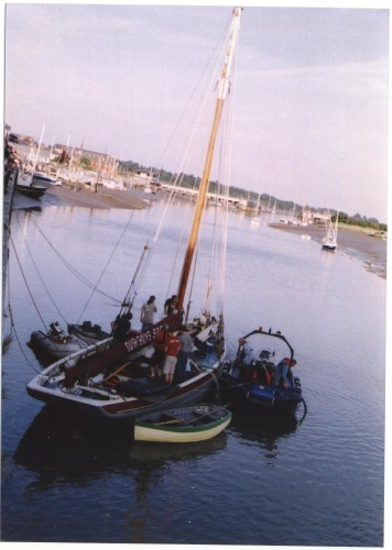 With help from the Sailing Club, Our Boys was successfully refloated the next day and was towed away to be repaired, with a 'tug' on one side and a dinghy with a pump on the other. | Jan Ward (via Nottage)
