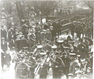 The band of a battalion of the North Staffordshire Regiment march past St Mary's Church. | Nottage Maritime Institute 04329.29