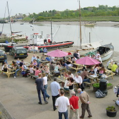 Crowd drinking outside The Rose and Crown on Wivenhoe Quay  | Photo: Peter Hill