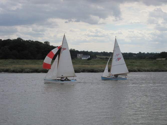 Wivenhoe One Design dinghies racing down river at the 2010 Regatta. | John Collins