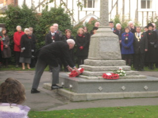 Roger Belsham laying a wreath on behalf of the Wivenhoe Branch of the Royal British Legion  | Peter Hill