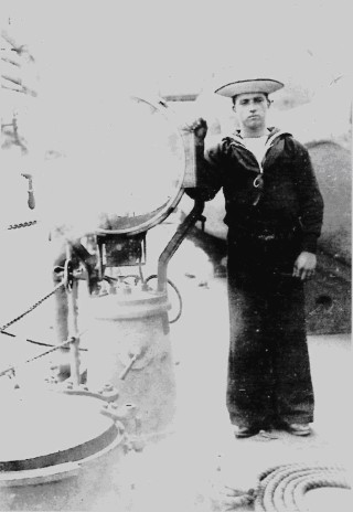 Boy Telegraphist Jack Durrell Green with signalling lamp.  | Nottage Maritime Institute