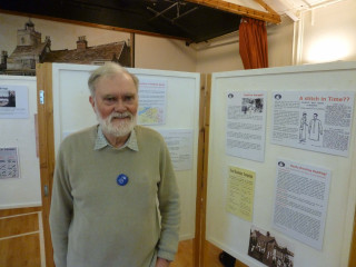 John Collins standing beside the display boards showing some of the information panels created by Lesley McCabe  | Photo: Peter Hill