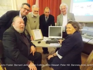 Baroness Anne Jenkin presses the button to launch the History Archive watched by John Foster, Bernard Jenkin, John Collins, John Stewart and Peter Hill  | Photo: Jeannie Coverley