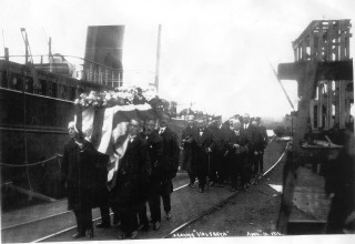 Bayard Brown's funeral procession leaving the Valfreyia in the dry dock. | Nottage MAritime Institute 04129
