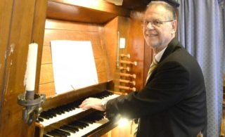 Graham Wadley playing the organ | Photograph taken by Essex County Standard Group