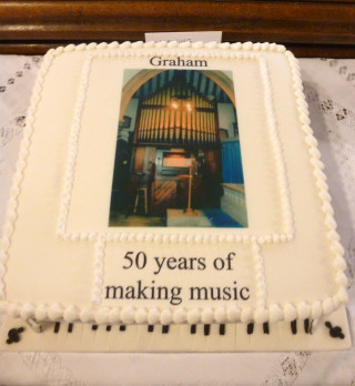 The cake made especially for Graham Wadley's celebration event at St Mary's Church by Joy Wilderspin and decorated with 'organ and music' by her husband   | Photo by Peter Hill