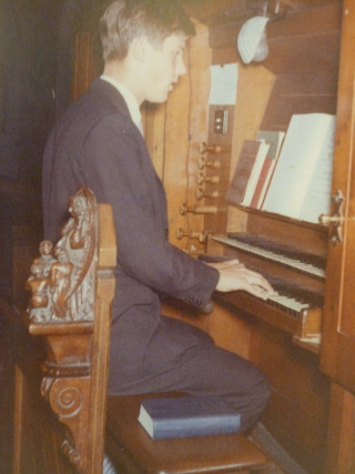 Graham Wadley as an even younger man playing the organ