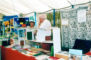 Pam Dan with Mark Paterson at Mark's book stall in the 2003 Wivenhoe Tent at the Tendring Show. | Photo by Peter Hill