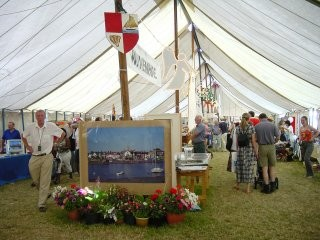 Robert Priseman's picture of Wivenhoe Quay in pride of place inside the Wivenhoe Tent. | Photo by Peter Hill