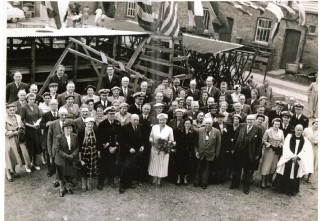 A party of people at the Wivenhoe Shipyard gathered for launch of a ship in about 1943. Ship launches were social occasions even then. Hylda Oxton, wife of the MD of the yard, is the lady in white holding a bouquet.   | Photo loaned by Barbara Husk