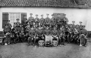 The Essex Band in 1916. This picture was taken outside a cottage in Lamotte-Buleux a tiny village in the Somme département in Picardie in northern France at Christmas 1916. | Photograph from the Essex Regimental Museum
