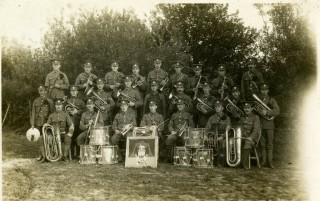 The photograph of the Band taken at Codford St.Mary, Wilts, whilst the 10th Essex Regiment was undergoing training with the 18th (Eastern) Division prior to going to France in July 1915. Horace Pitt is in the centre of the front row. | Photograph from the Essex Regimental Museum archives