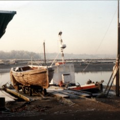 Guy Hardings Boat Yard Slipway 1980's - Old ships lifeboat in for repair. | Mike Downes