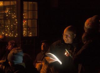 Joining in the carol singing - Dec 2015 | Photo:  Frances Belsham