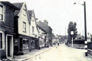 High St  from opposite the Church, the Falcon Pub on the right and various shops on the left | Photo Wivenhoe Memories Collection