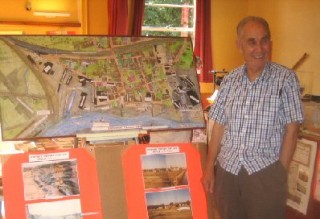 Bill with his model of lower Wivenhoe as it was in 1959 | Photo: Peter Hill