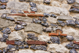 Roman terracotta tiles incorporated in the tower walls  | Photo: Frances Belsham