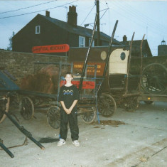 The various carts which were used in the filming of Plotlands were stored in the then Wivenhoe Port site. On the other side of the wall is West Street.  The boy in the picture is Christian Hill. | Photo: Peter Hill