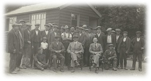 Workers of the Wivenhoe Quarry in its early days. The picture was taken outside what was then the office. It shows W.G. seated centre with Tom Forsgate, his foreman, to his right and Jack Glozier, who ran the office, to his left.