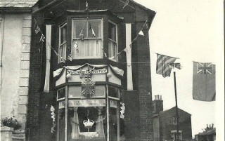 The Post Office decorated for the Coronation of Queen Elizabeth in 1953.  Mr and Mrs Bristow won first prize. | Photo: Jane Butt. Wivenhoe Memories Collection