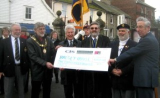 Cllr Tom Roberts, Wivenhoe Town Mayor presents a cheque for £1,000 to Dennis Donovan (standing right) of the RBL care home Halsey House. In the picture are Richard Gladwin (far left) who with Maurice Clary (with the beret) supervised the work, Standing centre are former Town Mayor Cllr Peter Hill with Pastor Patrick Baxter. | Wivenhoe Encyclopedia