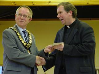 Rector Erwin Lammens receiving a cheque from Town Mayor Cllr Brian Sinclair  | Jason Cobb