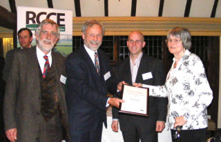 Tom Roberts, Peter Kennedy and Jane Cole in 2007 representing the editorial team of Wivenhoe News receiving the Merit Award at the RCCE Awards evening.
