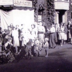George Slaughter's shop in the High Street in the early 1950s showing children queuing for sweets after the end of sweet rationing. | Wivenhoe Memories Collection