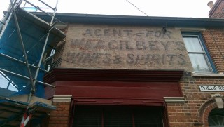 Stacey Wood's old signage uncovered during work to the building in 2016. | Wivenhoe Memories Collection