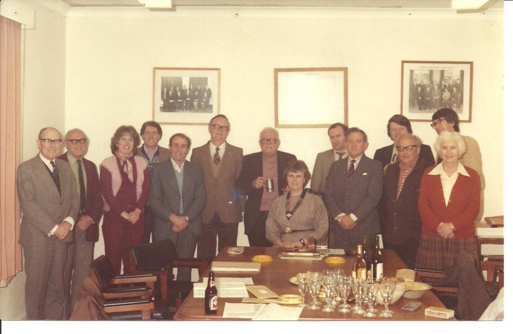 Wivenhoe Town Council Members 1983. L to R: John Potts (incoming Town Clerk), Peter Lang (Town Clerk), Antoinette Illsley (Secretary), Colin Oliver (Groundsman); Arthur Illsley (Senior Groundsman), Cllr Stan Croucher, Cllr Bill Sparrow, Town Mayor Cllr Val Last (seated), Cllr Glyn Davies, Cllr Derek Wilkinson, Cllr Mike Roots, Cllr Morris Britton, Cllr Austin Baines, and Cllr Margaret Dunne. | Mike Downes