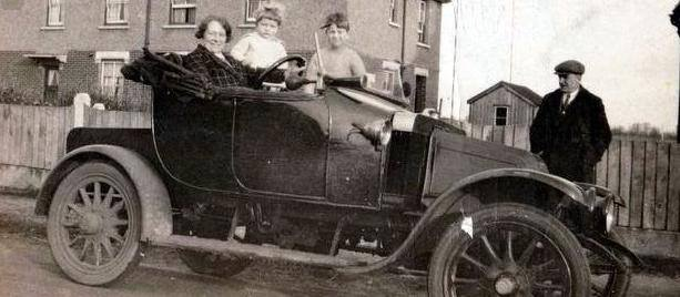 A young Philip Faucheux in the car with the owners, Mr and Mrs Barr. Taken in Rectory Road in the 1930s. | Wivenhoe Memories Collection