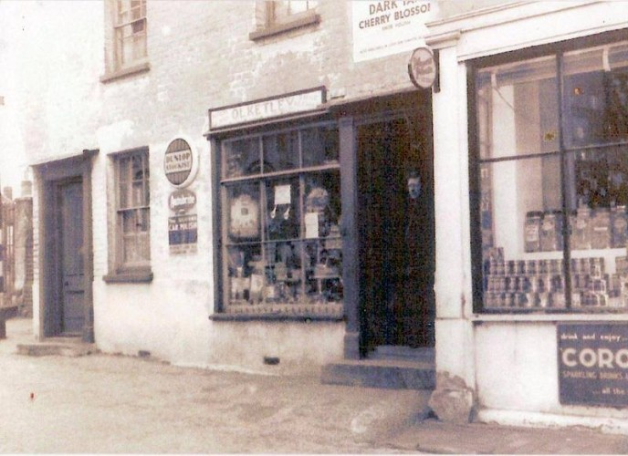 O. S. Kelly's Cycle and Motor Parts shop next to what is now the Village Delicatessen on the High Street. | Wivenhoe Memories Collection