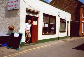Brian Green in the doorway of his fish shop on East Street | Wivenhoe Memories