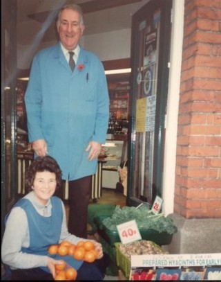 Gordon and Pat Green at the doorway of Barton's Stores on the High Street | Photo by Linda Panton