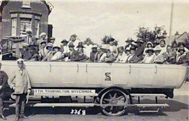 A load of happy holidaymakers about to depart on a Silver Queen charabanc excursion from Rosemary Road, Clacton, for a tour of the Essex countryside, including Wivenhoe. The Silver Queen stand was on the site of the present Edinburgh Woollen Mill shop at the junction of Rosemary Road and Pier Avenue. | Wivenhoe Memories Collection