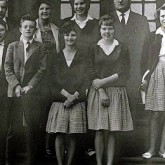 Some Scholars from Brightlingsea Secondary Modern School in 1958-60 (taken in Chelmsford): Sylvia Went, second from right and Pauline Bellman on the back row. Carol Clark, Thelma Wilson, Kenny Ryder on the front row.  The teacher is John Appleby. | Wivenhoe Memories Collection