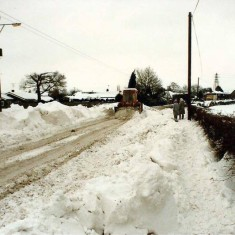 Snow drifts on Colchester Road 1987. Wivenhoe was cut off until a loading shovel was sent up from Wivenhoe port to clear the snow. | Wivenhoe Memories Collection