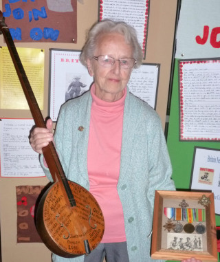 Mrs Margaret Britton with her grandfather's war medals and three-stringed instrument he took with him to WW1  | Photo by Peter Hill (October 2014)