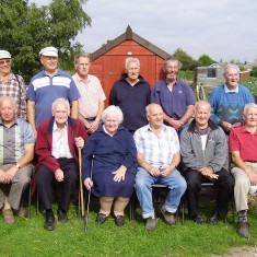 The people who had cultivated an allotment the longest in 2005. Standing left to right: John Binks, Derek Evans, Fred Purdey, Charles Sansom, Sid Cox, Sid Hadler Seated left to right:   Brian Blake, Les Dykes, June Dykes, George Bulmer, Tony Krysinski, Phil Faucheux    | Photo by Toni Stinson