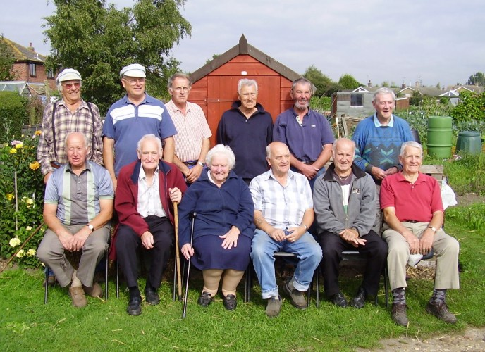 The people who had cultivated an allotment the longest in 2005. Standing left to right: John Binks, Derek Evans, Fred Purdey, Charles Sansom, Sid Cox, Sid Hadler Seated left to right: Brian Blake, Les Dykes, June Dykes, George Bulmer, Tony Krysinski, Phil Faucheux