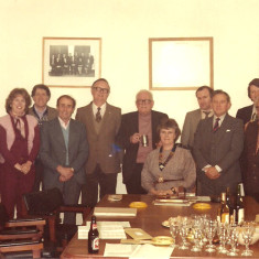 Wivenhoe Town Council - Staff and Councillors in 1983 at a celebration to mark Cllr Bill Sparrow's retirement from the Council. From LtoR: John Potts (newly appointed Town Clerk), Peter Lang (outgoing Town Clerk), Antoinette Illsley (Secretary), Colin Oliver (at the rear) and Arthur Illsley (both Groundsmen), Cllr Stan Croucher, Cllr William Sparrow. Cllr Val Last (Town Mayor - seated), Cllr Glyn Davies, Cllr Derek Wilkinson, Cllr Mike Roots (standing at the back), Cllr Maurice Britton, Cllr Austin Baines, and Cllr Margaret Dunne.