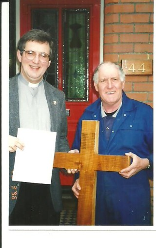 In 1996 Colin Oliver made a Cross from the timber saved from the Lime Tree which once stood in the Churchyard but which fell down during the gales of 1987. He presented it to St Mary's Church. He is seen here with Rev David Thomas, then Rector of St Mary's Church, Wivenhoe. | Antoinette Stinson