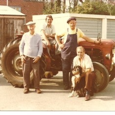 LtoR: Johnny Turner, Colin Oliver, Cyril Rainbow and Arthur Illsley with Antoinette's dog Jubal taken in 1976 in the Council yard with our lovely old Massey Ferguson tractor.   | Photo by Antoinette Stinson